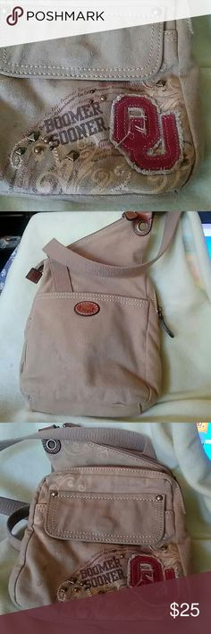 FOSSIL OU Xbody Can you say Boomer Sooner? So here's his specialty from fossil brand an OU crossbody. Fossil Bags