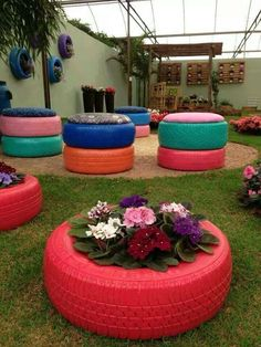 Sprayed tire planters & outdoor chairs. Mais