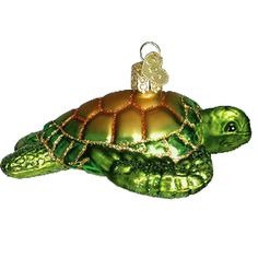 """Green Sea Turtle Christmas Ornament 12167 Merck Family's Old World Christmas Made of mouth blown, hand painted glass. Turtle measures approximately 4 3/4"""" According to Wikipedia:"""