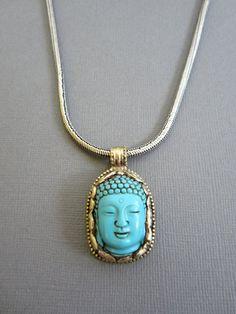 Tibetan Turquoise buddha head necklace, Buddhist jewelry, bezel framed buddha head necklace. Buddha Head Charm. $108.00, via Etsy.