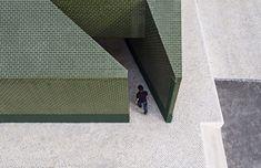 Green tiles and geometric entrances create distinctive graveyard toilets