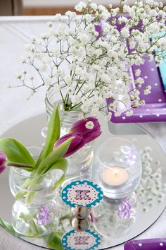 Baby shower centerpiece - Baby's breath bouquet and purple tulips