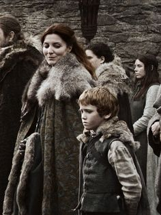 Rickon and Catelyn Stark from the first episode. I miss these Winterfell days...