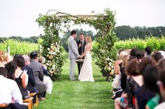 Wedding Ceremony, Wolffer Estate Vineyard, Flowers by: Lewis Miller Design, Photo: Samuel Lippke Studios - Sagaponack Wedding http://caratsandcake.com/josephineandpeter