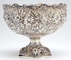 Steiff Baltimore Rose footed sterling punch bowl with all-over repouss' floral decoration, applied floral rim, ca. 1890. 76 ozs. troy; 12 dia., ht. 10.