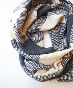 Cashmere Merino scarf in a checkered pattern. The hand woven scarf is chic, chunky and warm, the perfect accessory for the cooler months of the year. Chic and casual, wrap it around yourself once to ward off cool autumn winds, or twice to really immerse yourself in its warmth and protect against freezing winter months Size 12 x 77 30 x 194 cm, with simple knot fringes Care instruction Dry clean OR Soak in cold/finger warm water with wool detergent, squeeze out water gently and roll it in a…