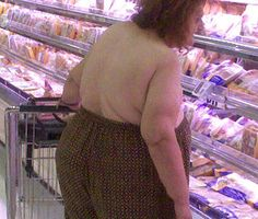 """This lady actually thought to herself:  """"I don't need a shirt today. I'll just tuck my tatas into my pants.    Let's go to Walmart!"""""""