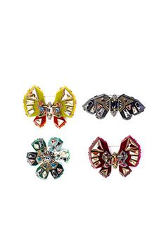 The Accoutrement  Brooches are no longer just your grandmother's accessory. Lanvin is reinvigorating this accoutrement by way of an eye-catching art deco¬-inspired brooch whose glittering jewels are fit for fashion-forward women of all ages. Lanvin insect brooches, $760–$1,027;  for more information, go to 	 	lanvin.com   - ELLE.com