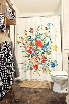 Lovely Urban Outfitters shower curtain in white Bath. Love the towels and storage ideas too.
