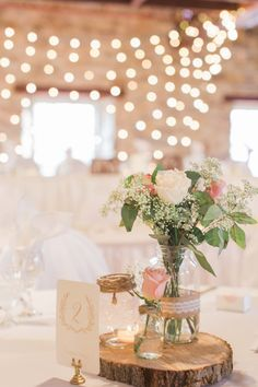 My favourite thing about the decor were the strings of globe lights we set up behind the head table and around the venue. I was inspired by a friend's barn wedding with thousands of lights, and loved the warm glow they added to the night! http://www.confettidaydreams.com/dreamy-summer-garden-wedding-with-romantic-rustic-barn-details/ Pics: Brittany Lee Photography