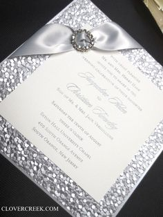 Silver invite with crystal buckle.