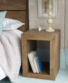 Simple Minimalist Bedside Design Inspiration Having Natural Wooden Element With Cube Shape Detail And Two Open Side Appearances Ideas. This bedside presents old school strength and functionality with on-trend rustic design elements. Very simple but succeed to blend with the interior surrounding. Offering a unique combination of grain and color variations with natural imperfections.