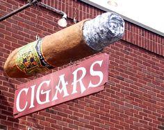 mireia: un puro y su ceniza para representar una tienda de tabaco