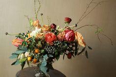 "Via ""Flower School"" Flowers used: Poppies, hellebores, ""combo"" roses, hyacinths, thunbergii spierea, 3 varieties of eucalyptus, ranunculus, silver brunia, ""orange prince"" parrot tulips, daffodils, fritillaria and tuberose"