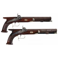 A pair of percussion saw handle pistols made by W&G Tarot of London, early to mid 19th century.