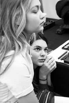 Cute: Kendall looks on attentively as model Gigi Hadid gets her make-up done backstage...