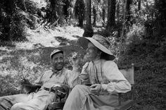 Legendary actors Humphrey Bogart and Katharine Hepburn relaxing on the set of 'The African Queen' in (Eliot Elisofon—The LIFE Picture Collection/Getty Images) Classic Hollywood, Old Hollywood, Hollywood Couples, Bogie And Bacall, John Huston, Queen Photos, Katharine Hepburn, Humphrey Bogart, Life Pictures