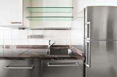 everything reflects your image like a mirror in this kitchen designed of stainless steel, glass and marble