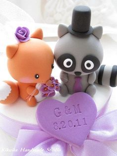 SOOO CUTE!  Raccoon and fox Wedding Cake Topper. $120.00, via Etsy. #weddingcakes