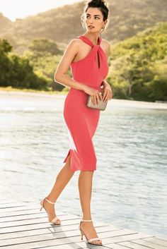 Summer wedding on the horizon? This gorgeous coral bodycon number is perfect for a beach wedding!