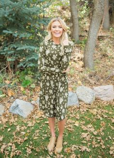 The Isla Olive Floral Print Dress will be your new closet favorite! This dress features an olive base with white antique floral pattern all across the body. || Bella Ella Boutique. Fall. Fashion. Womens Online Boutique. Dress.