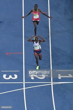 Britain's Mo Farah wins the Men's 10000m followed by Kenya's Paul Kipngetich Tanui during the athletics event at the Rio 2016 Olympic Games at the...