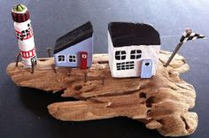 driftwoodhouses on driftwood - here a lighthouse
