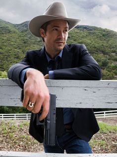 Timothy Olyphant. The hat. The glock. The ring. The fence. The hills. What's not to love?