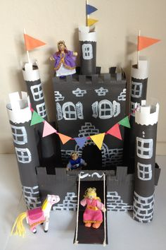 Cardboard castle craft- made from stuff around the house. Shoebox, cereal box, paper towel rolls, TP roll. Easy & cute!!