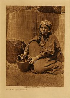 c 1909 Chinook Indian woman at Wishram village (near the now flooded Celilo Falls on the Columbia River)  photo: Edward S. Curtis (near Celilo Falls, Columbia River)  (Native Americans of Oregon and Washington) wooden bowl, basket, woven mat