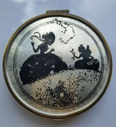 VINTAGE 1930s BLACK SILHOUETTE SILVER GUILLOCHE ROUGE AND POWDER COMPACT.