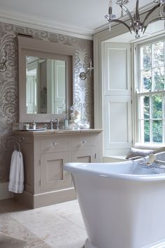 Like the use of wallpaper, the tone of the cabinets and the chandelier over the tub. Bathrooms & Tiles / Hayburn