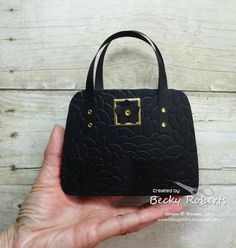 I dressed up one of the Fashionable Favorites purses in Basic Black last week with the Petal Burst Embossing Folder. Boy, did that give i...