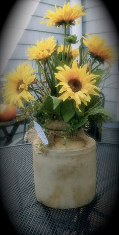 Sunflowers in an old crock