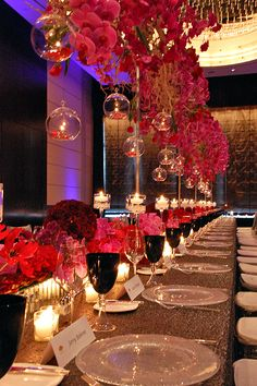 Glass-baubles filled with candles, with flowers suspended from above the tables at your #weddingreception! Gorgeous!!!