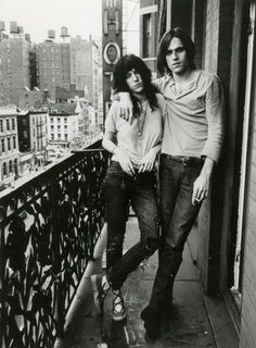 Patti Smith and Eric Andersen posing on the balcony at the Chelsea Hotel in NYC, 1973
