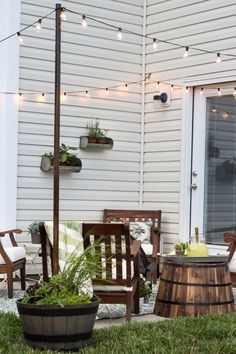 How to Decorate a Small Patio | blesserhouse.com - Utilize a small patio space with chairs at each corner and a fire pit in the middle for function and entertainment. Add outdoor string lights for a c