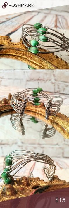 Green Beaded Handmade Silver Wire Bangle Bracelet Very unique wire bangle bracelet. Handmade with beautiful green beads. Cute bohemian bracelet. Stack with other bracelets or wear alone. There is a bit of tarnishing and signs of regular wear. No major flaws.  💡🔆Bundle the inexpensive items in my closet with the pricier ones to take advantage of my bundling discount!🔆💡 Jewelry Bracelets