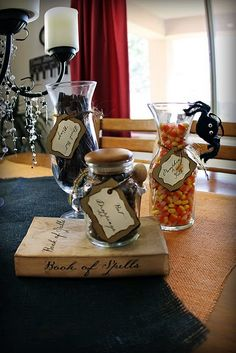 """different """"witches brew"""" ingredients sat on the table for passerby's to enjoy.. this would also be cute at a kids party.. candy in the jars instead of any of those plastic gross halloween decorations."""