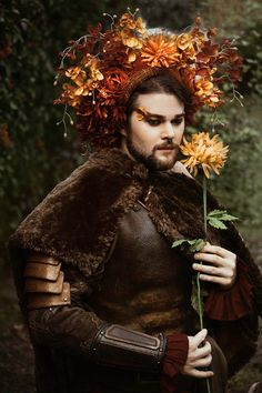 I love men in floral headdresses. Photo: Elizabeth Elder Photography  Model: Bryan Forrest Armor: @swordandthestone  Cape: @lilms_whipstitch  Bracers: @bryson_keefer  Headdress: Miss G Designs #headdress #headpiece #missgdesigns #flowercrown #flowerheaddress