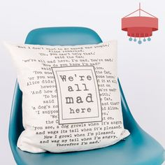These pillows featuring a passage from Alice in Wonderland are the perfect decorating idea for home libraries.