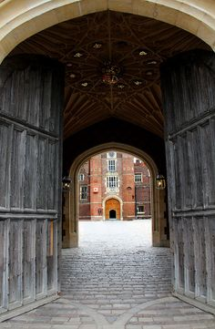 BEAUTIFUL PHOTOGRAPH OF THE ENTRANCE INTO HAMPTON COURT PALACE ~ ALL MY FAVORITE MEDIEVAL ROYALS WALKED, RODE HORSEBACK OR IN A ROYAL CARRIAGE RIGHT THROUGH THESE DOOR'S. INCREDIBLE.
