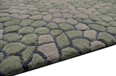 A fully Bespoke hand tufted New Zealand rug in green and beige. It has a pile depth of 10-12mm. Created using the customers own design. #CustomRugRoom