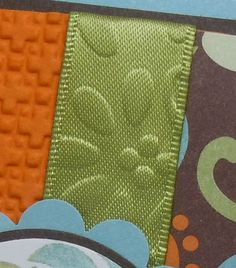 """Embossed Ribbon - """"I used """"Stiffen Stuff"""" (found at your local craft store) and it worked beautifully.  You simply spray the ribbon, pop it in the microwave for 30-40 seconds and you'll have nice crisp ribbon.  Then you're ready to run it through your Big Shot using the embossing folder of your choice."""""""