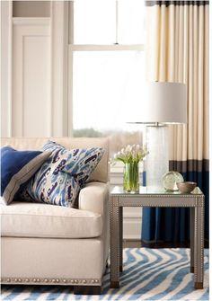love the nailhead trim on sofa + color blocked drapery, muse interiors