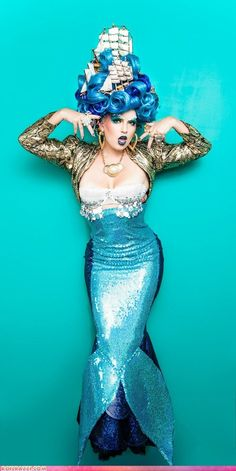 Great mermaid costume. Love the ships in the hair!