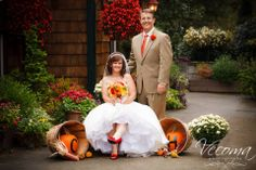 Out on our front patio, this couple had some great shots with their fall mum and pumpkin display.  #fallweddings #mumsandpumpkins @Vecoma at the Yellow River