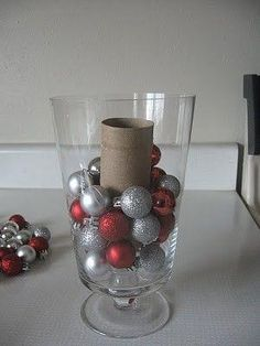 Remember to use a toilet paper roll as a filler- makes ornaments go further in filling vases! smart!! by debra