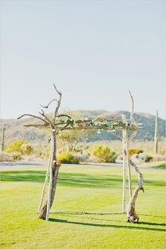 Organic wedding arch ideas. Captured By: Elyse Hall Photography ---> http://www.weddingchicks.com/2014/06/02/desert-wedding/