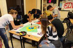 Painting murals during art class